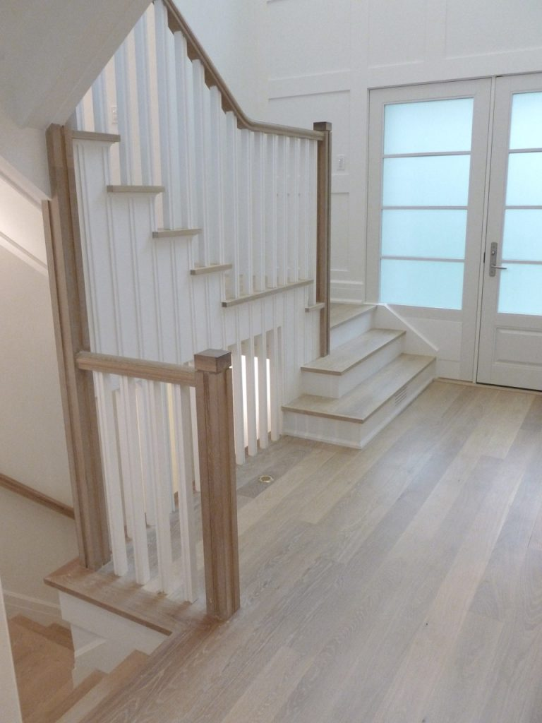 After: The stairs and entryway are light and airy, a very inviting space for The Greenwich House