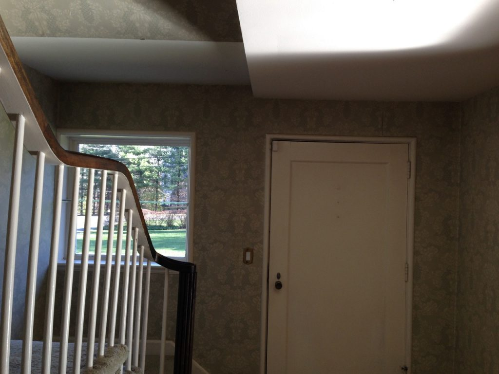 Before, the entryway was dark and dingy at The Greenwich House